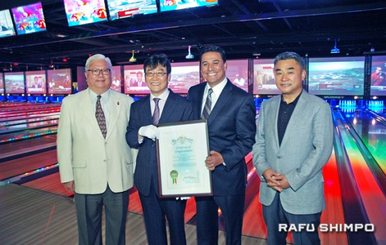 L.A. City Councilmember Jose Huizar (third from left) presented X Lanes investment partner David Lee with a certificate of congratulations at the grand opening. At left is Mike Okamoto of the Little Tokyo Community Council and at right is investment partner Kevin Kang. (MIKEY HIRANO CULROSS/Rafu Shimpo)
