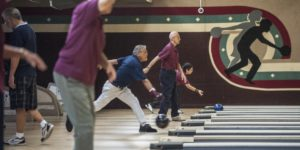 Members of the Nikkei Seniors toss their balls down the lanes early one morning at the Linbrook Bowling Center in Anaheim. Linbrook, the oldest bowling center in Orange County, was packed with league players on a recent morning. MARK RIGHTMIRE, STAFF PHOTOGRAPHER
