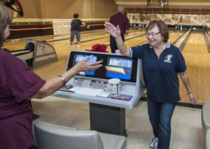 Sumi Yakura, 81, of Westminster and a member of the Nikkei Seniors bowling group, is congratulated for her strike early one morning at the Linbrook Bowling Center in Anaheim. MARK RIGHTMIRE, THE OC REGISTER